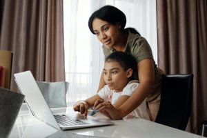 parent and child in front of computer