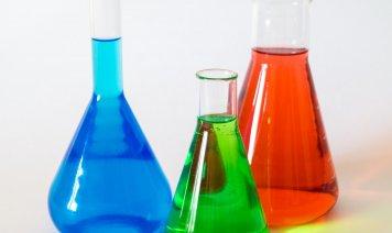 Colored liquids in glass beakers
